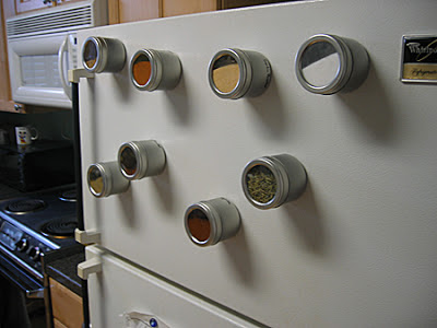 magnetic spice tins on refrigerator door