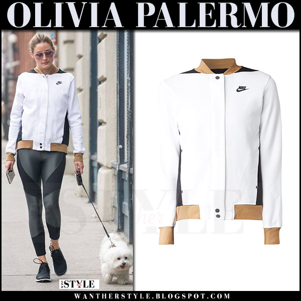 Olivia Palermo in white fleece nike jacket and black leggings walking her dog july 2017 what she wore