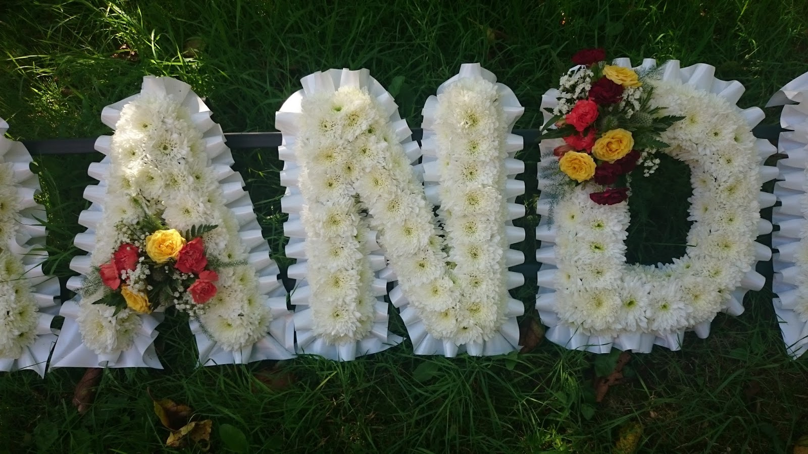 Sandras flower studio funeral tribute flowers grandpa with white ribbon and autumn colour sprays izmirmasajfo
