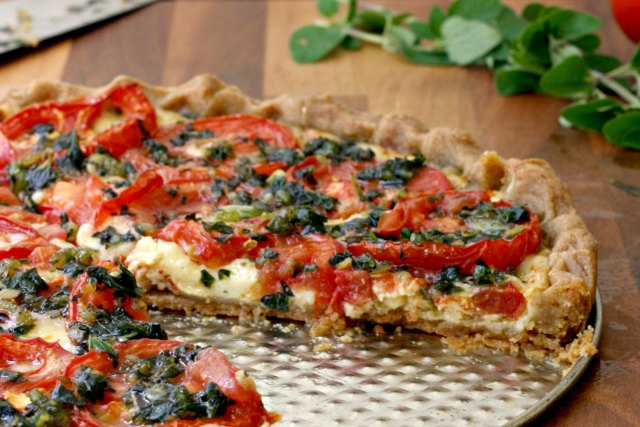 Summer Tomato Tart: A cheesy tomato tart with fresh herbs on buttery pastry. A thin layer of Dijon mustard spread under the tomatoes gives it a little bite.