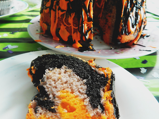 Orange, black, and purple marbled bundt cake