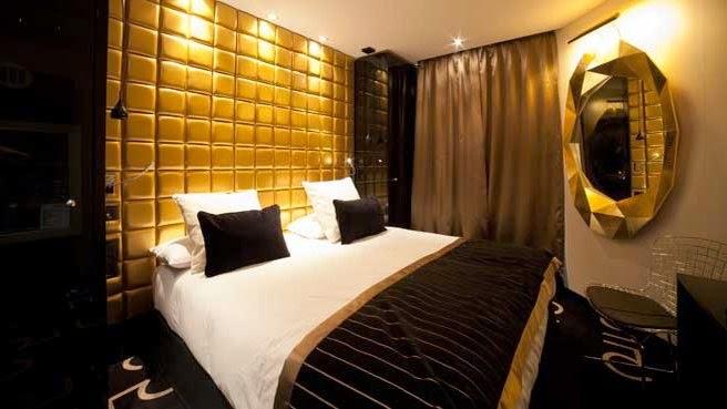 Dormitorio acentos dorados