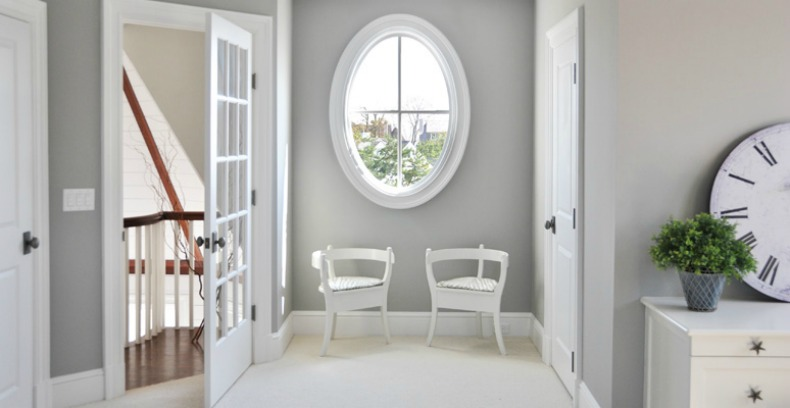 Coastal hallway with modern white chairs and a peek at the ocean