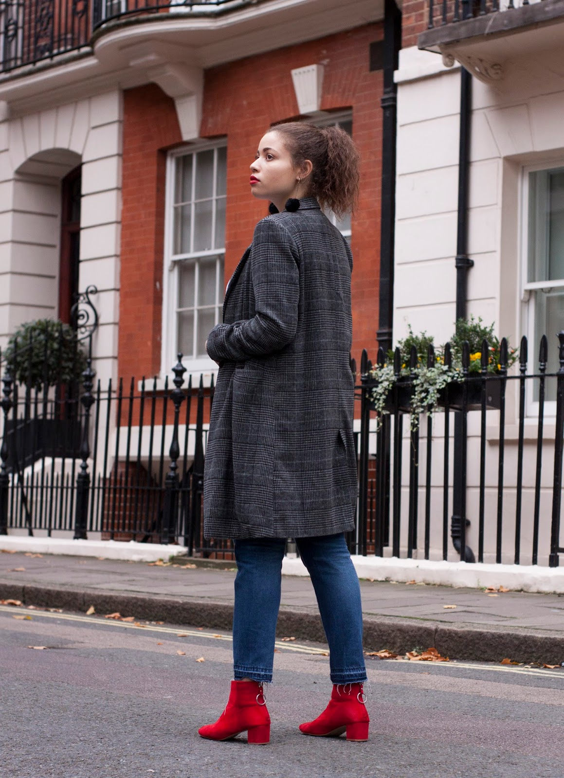 Eboni wearing grey check pretty little thing coat with red boots