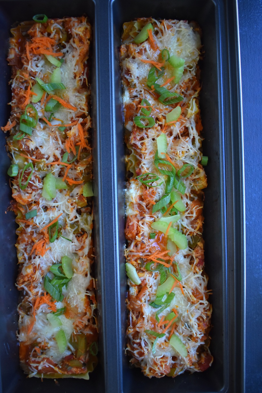 Buffalo Chicken Lasagna is loaded with spicy buffalo flavor, shredded chicken, celery, carrots, onions and is covered in melted cheese. It is rich and creamy making it the perfect filling dinner! www.nutritionistreviews.com