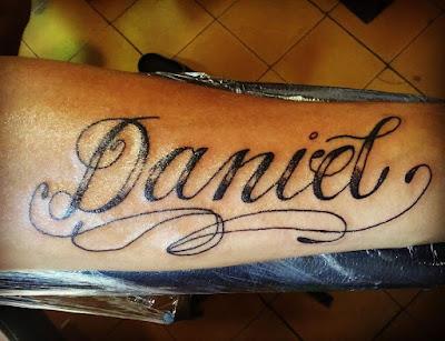 Nombre tattoo