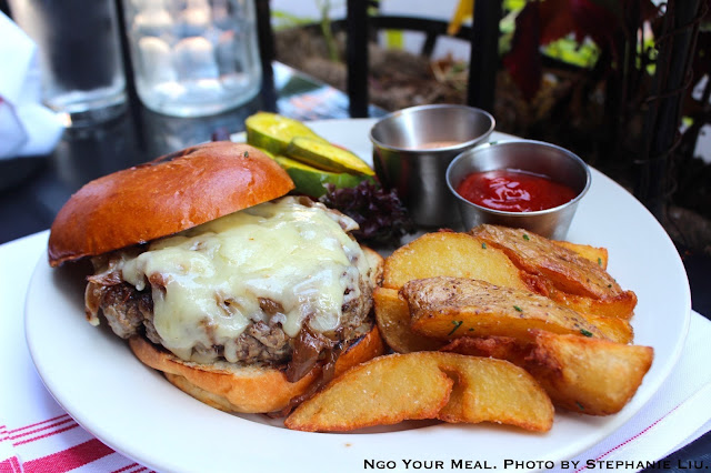 Bone marrow & Brisket burger with Tarentaise cheese, carmelized onions, crispy potato wedges at Swine