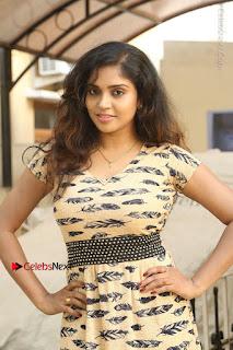 Telugu Actress Karunya Chowdary Stills in Short Dress at ATM Not Working Press Meet  0015.jpg