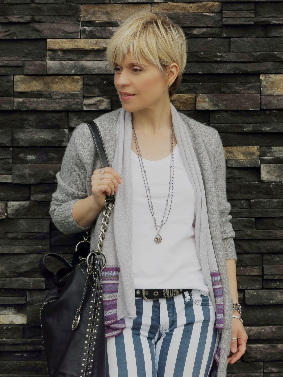 women's short hairstyle and outfit accessories