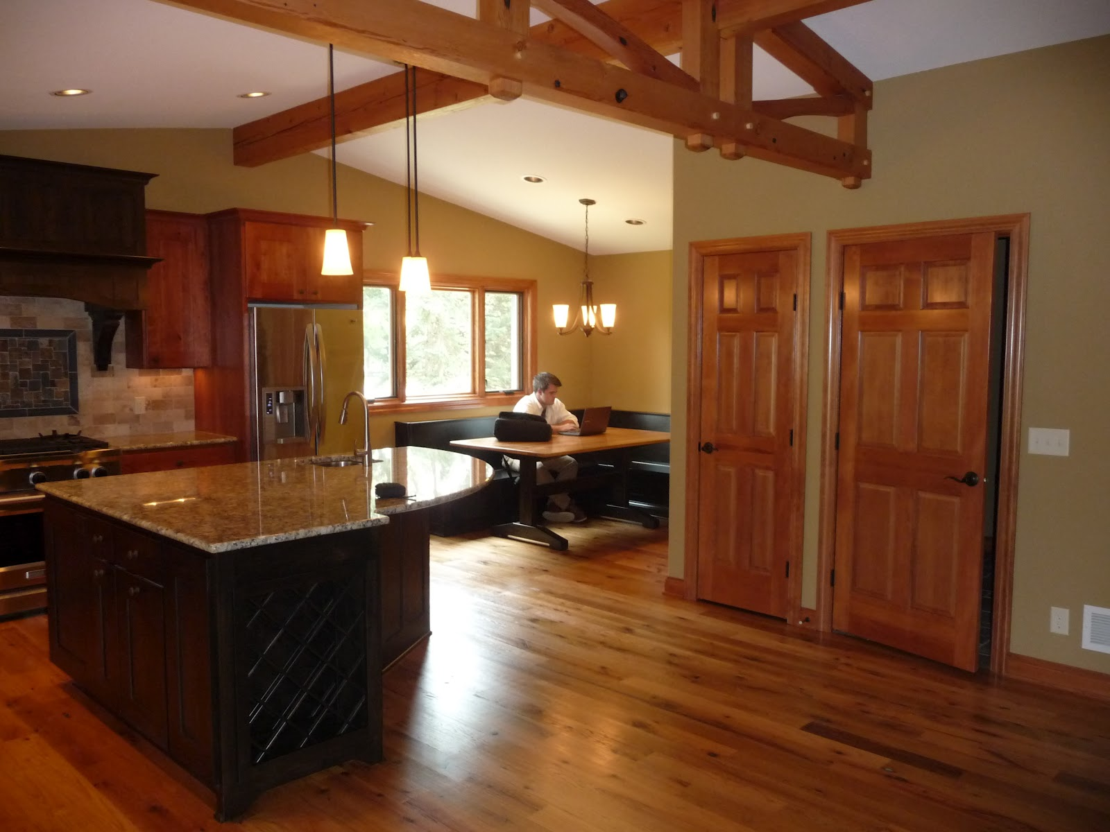 what to do with aging tri level home split level kitchen remodel To provide some order to the room and to help define the spaces we added a timber frame truss to the ceiling This truss was built by New Energy Works