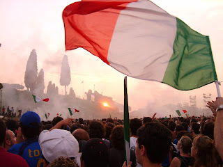 Italian fans celebrate at the Circus Maximus in Rome, where captain Fabio Cannavaro and his team showed off the trophy after winning the 2006 World Cup