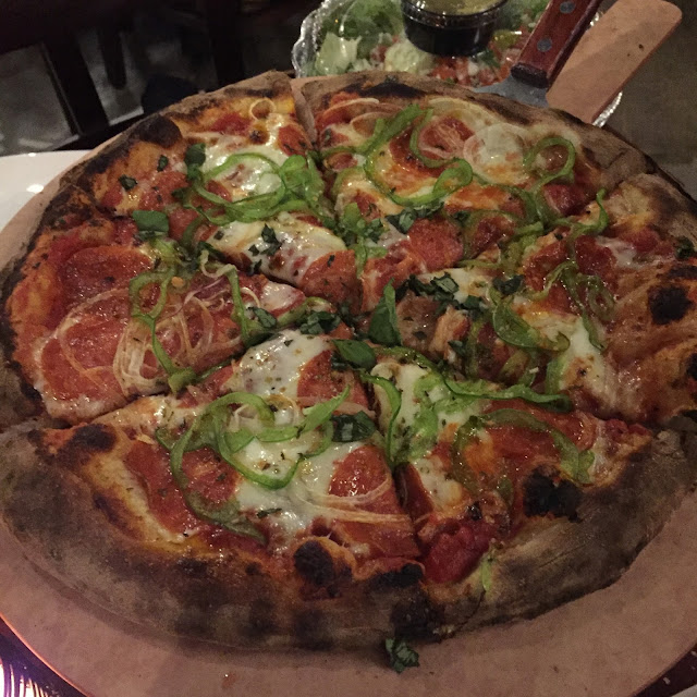 Green pepper, onion, basil and pepperoni pizza at SLYCE