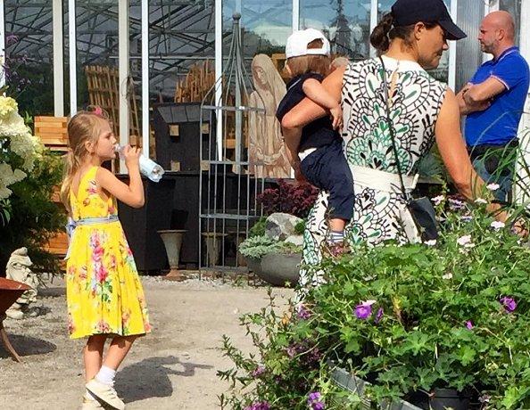 Crown Princess Victoria, Princess Estelle and Prince Oscar were seen Ulriksdal Palace Garden in Solna. Vore print dress
