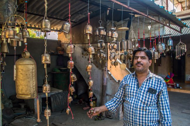 A bell maker with his creations