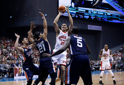 Japeth shooting over three Bolts Defenders
