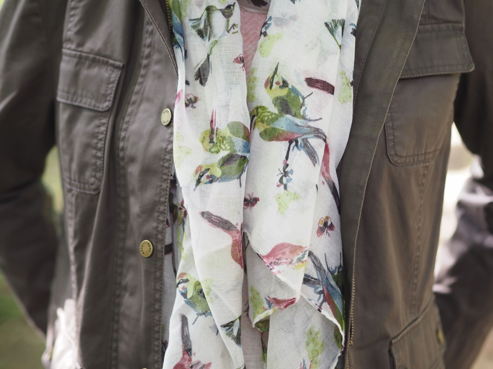 Dash khaki waxed jacket, pink jumper, skinny jeans, brogue style Chelsea boots and birds of paradise scarf, country style