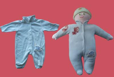 bambola con tutina neonato
