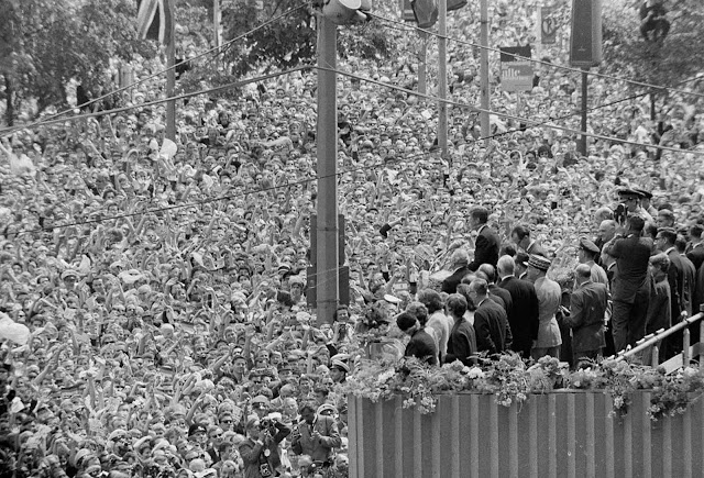 A cheering crowd, estimated by police at more than a quarter of a million, fills the area beneath the podium at West Berlin's City Hall, where U.S. President John F. Kennedy stood. His address to the City Hall crowd was one of the highlights of his June 26, 1963 visit to West Berlin, where he received one of the greatest receptions of his career.