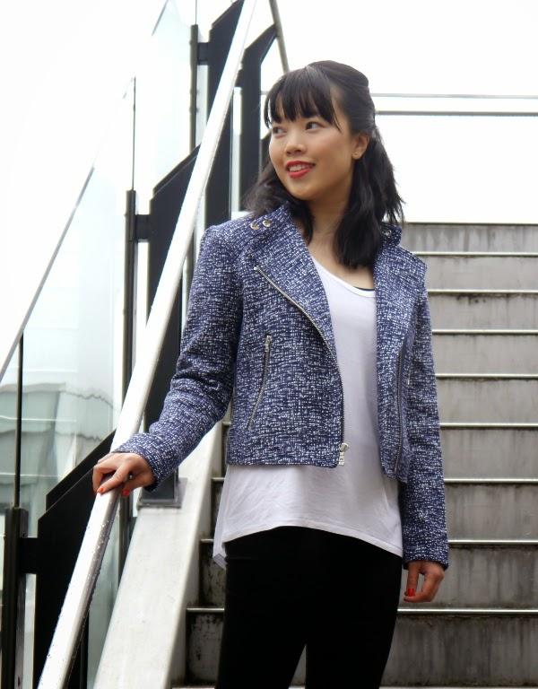 Blue textured moto jacket worn with a loose white tee