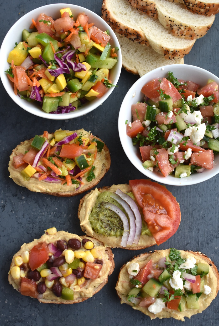 Hummus Toast- 4 Ways features Greek hummus toast, guacamole hummus toast, rainbow vegetable hummus toast and black bean and corn hummus toast for a tasty meal, snack or appetizer ready in 5 minutes each!