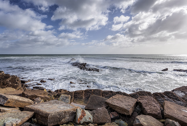 Clouds over rough seas at Peveril Point in Dorset