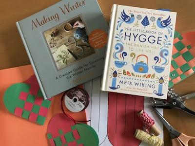Making woven paper hearts and hygge books