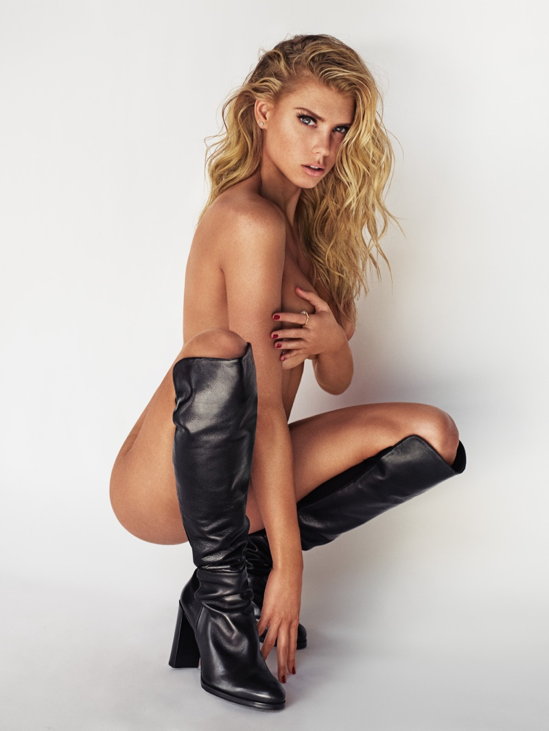 Charlotte McKinney wears black knee-high boots while posing naked