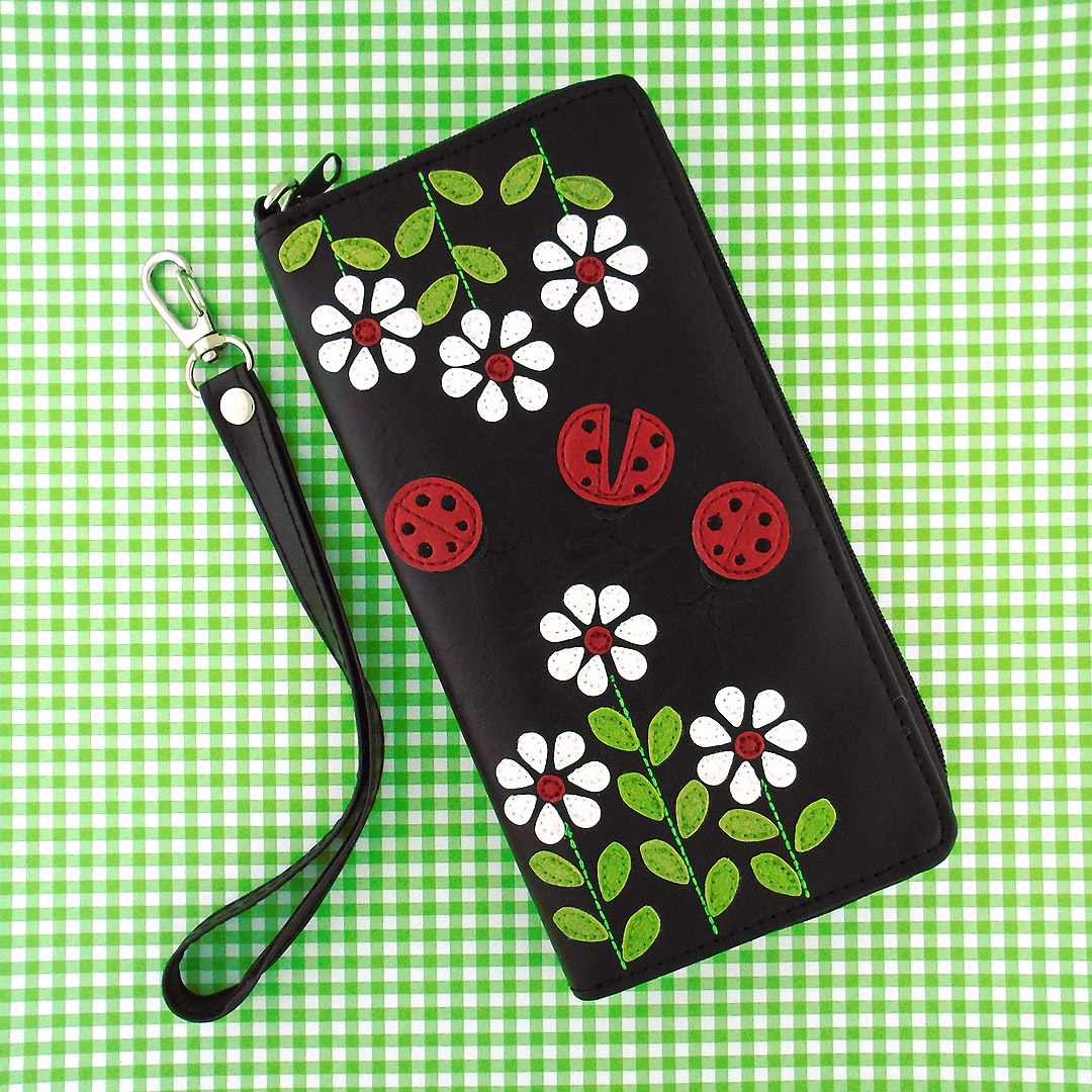 LAVISHY introduces NEW wristlet large wallet with lady bug and daisy flower appliques for Spring 2018. See more at http://www.lavishy.com/lookbook/lavishy-adora-collection-look-book.htm