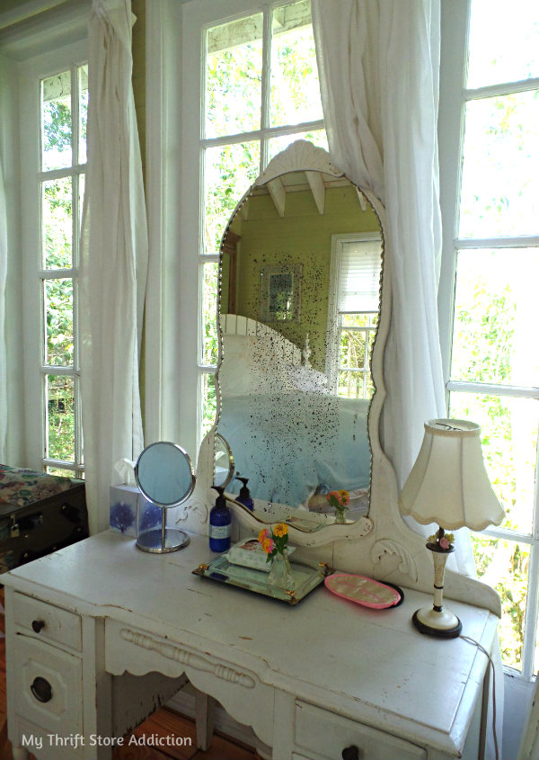 A Secluded Stay at the Bide-A-While Retreat mythriftstoreaddiction.blogspot.com Vintage furnishings like this beautiful antique vanity fill each room!