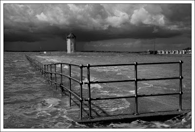 Batemans Tower, seaside, Derek Anson, essex, photographer, photography,storm clouds, railings, beach huts, Batemans Tower before the storm,