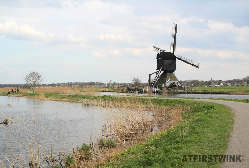 kinderdijk black windmill waterwheel wide view