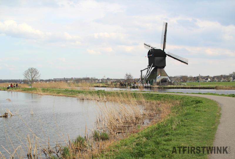 kinderdijk black windmill waterwheel wide view