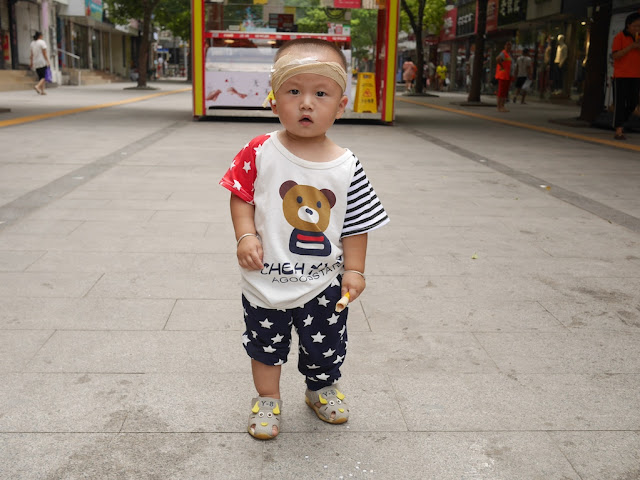 little boy wearing clothing with a red, white, and blue stars & stripes design