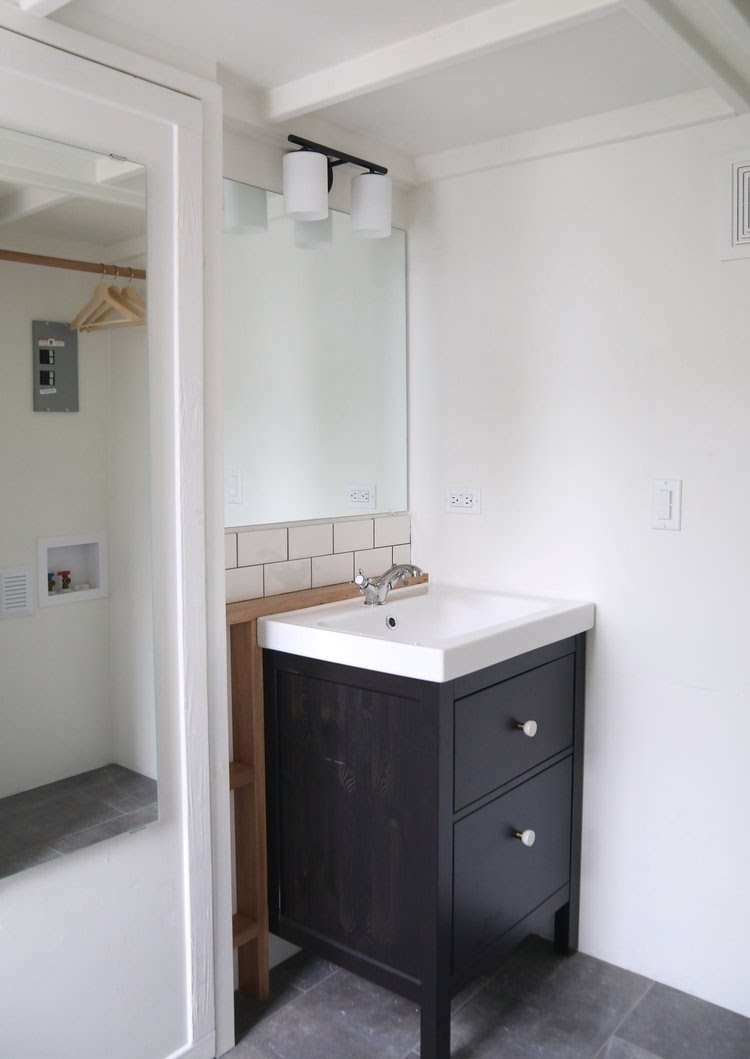08-Shower-Room-Sink-Handcrafted-Movement-Architecture-Tiny-House-on-Wheels-with-plenty-of-Windows-www-designstack-co