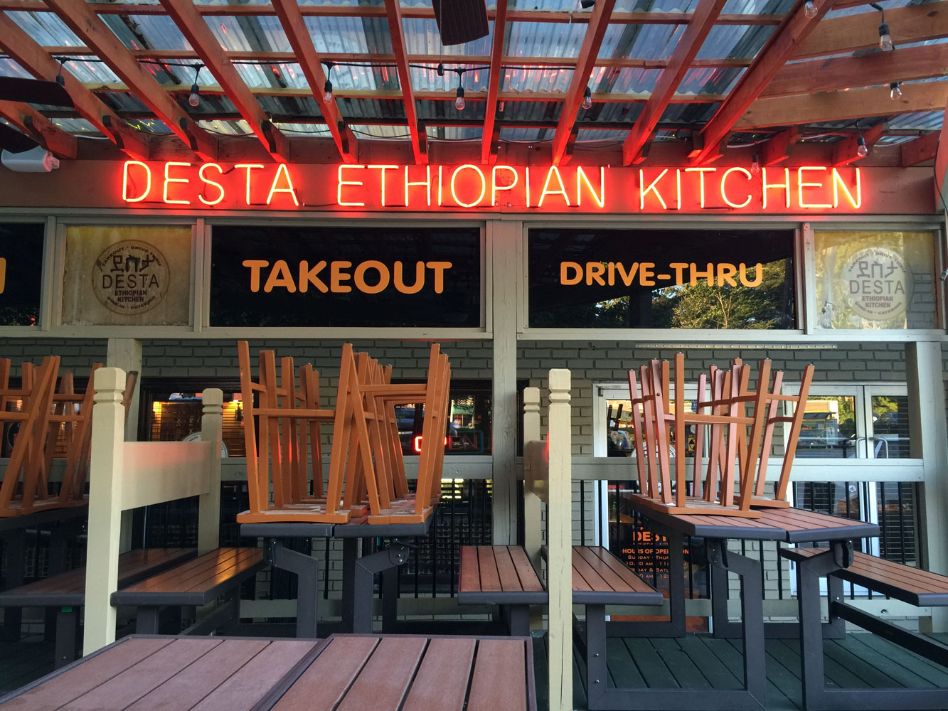 the building that houses desta is a bit quirky with dining on the second floor theres a bar and a patio that becomes quite full when its not too hot - Desta Ethiopian Kitchen