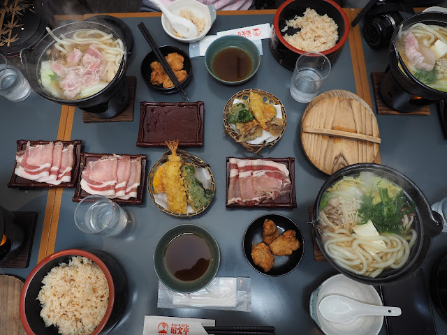 Kamameshi cuisine (traditional Japanese rice dish cooked in an iron pot)
