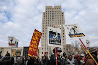 People march past the North Dakota State Capitol building during a protest in Bismarck against plans to pass the Dakota Access pipeline under Lake Oahe and near the Standing Rock Indian Reservation, North Dakota, U.S. November 14, 2016. (Credit: Reuters/Stephanie Keith) Click to Enlarge.