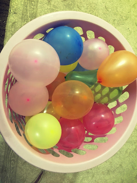 a basket of balloons with different colors
