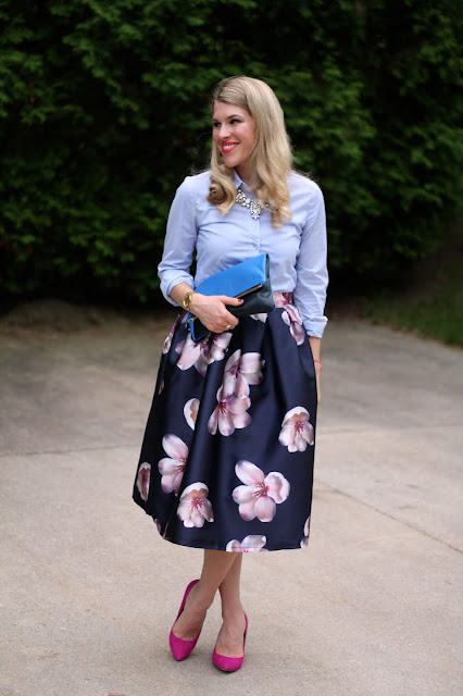 navy floral skirt, pinstripe button up, pink heels, blue Clare V. clutch