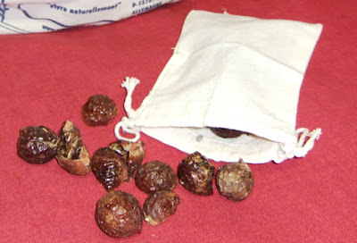 soapnuts being added in muslin sack to be used as detergent substitute