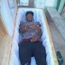Is This Madness or Style? Yahoo Boy Poses Inside Casket (See Reason & Photos)