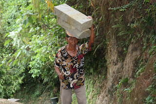 A woman carrying stone in Bali