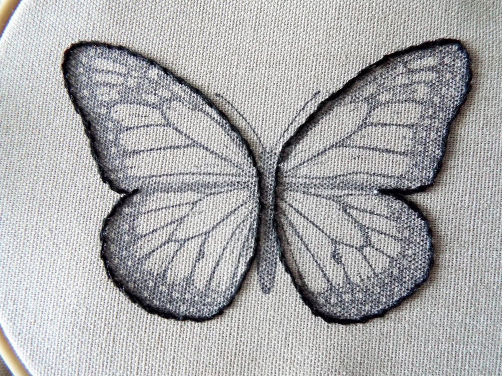 maxam made studio stitching a butterfly applique