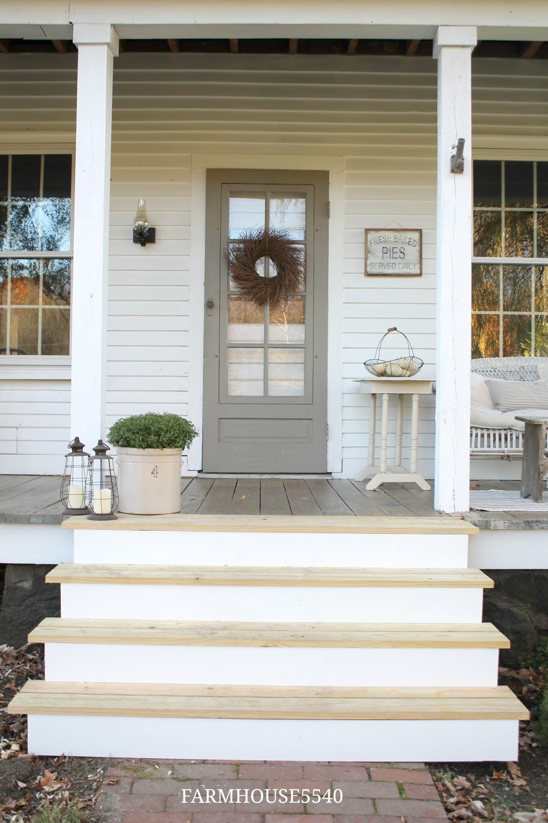 Farmhouse 5540 our farmhouse front porch for Farm door ideas