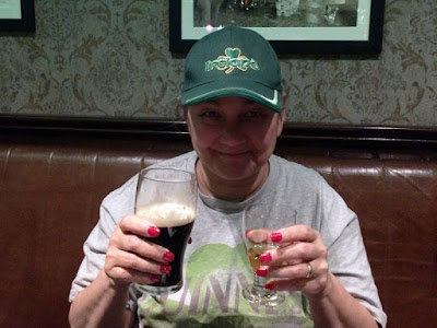 Me with a Guinness and shot of Jameson at the Doheny & Nesbitt, Dublin, Ireland.  I am wearing the cap given to me by a family of locals.