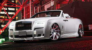 Slammed Rolls-Royce Dawn with 24-inch Forgiato wheels