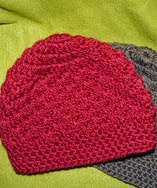 http://www.ravelry.com/patterns/library/lisas-warm-winterhat
