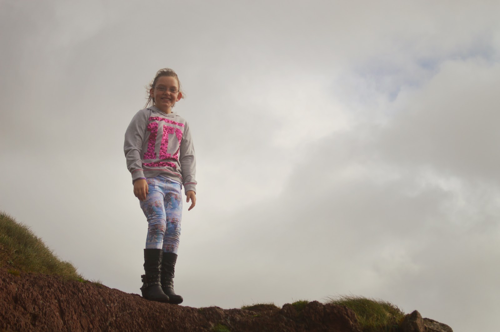 Rebecca on top of Rocks at Manorbier Beach, Pembrokeshire