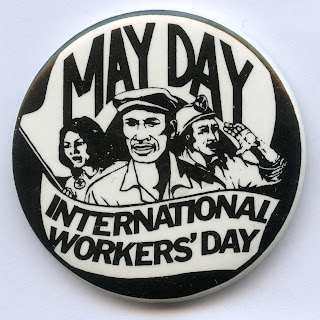 A 1970s button celebrating May Day or International Workers' Day