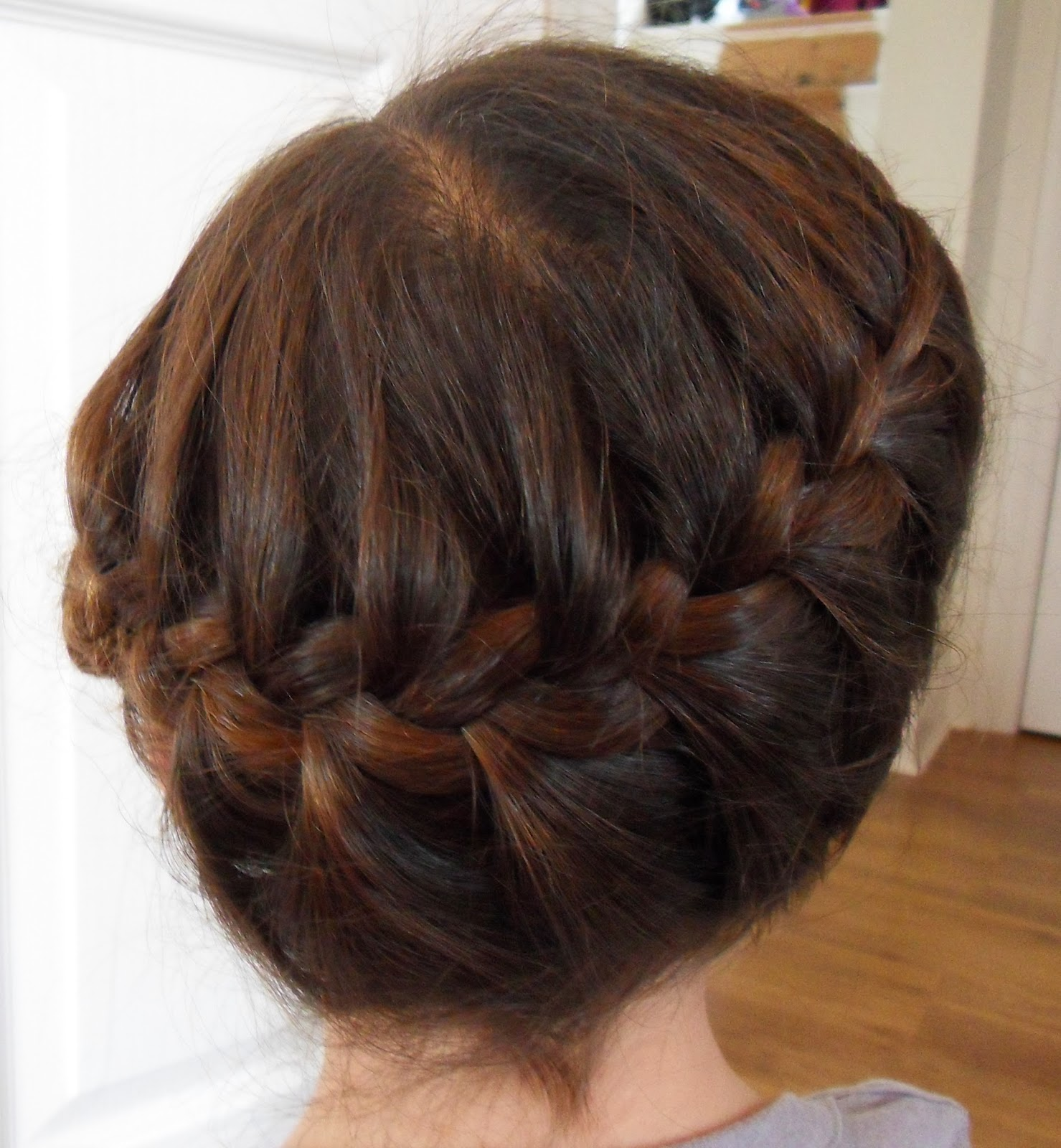 2 Continue To French Braid Around The Back Of Head Trying Stay In Middle As You Go And Aim For Just Above Top Ear